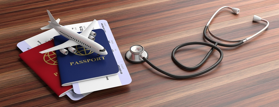 Blue And Red Passports And Medical Stethoscope Isolated On Woode